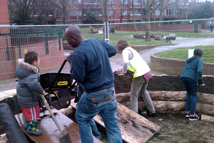Volunteers and residents filling the raised beds